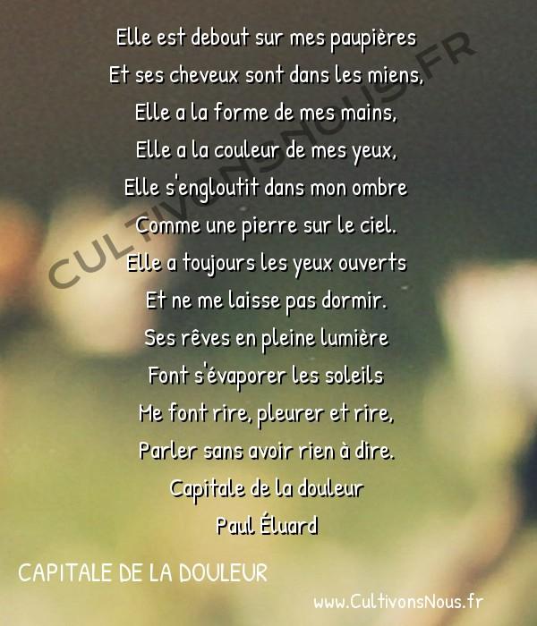 Poésie Paul Eluard - Capitale de la douleur - L'amoureuse -  Elle est debout sur mes paupières Et ses cheveux sont dans les miens,